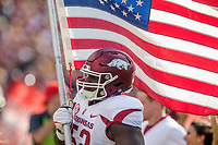 Hawgs Illustrated/BEN GOFF <br /> T.J. Smith, Arkansas defensive lineman, carries the U.S. flag as Arkansas takes the field before the game against South Carolina Saturday, Oct. 7, 2017, at Williams-Brice Stadium in Columbia, S.C.