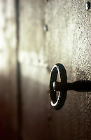 Close up of the handle of a bespoke iron cabinet made by local blacksmith Fabbro Candeago