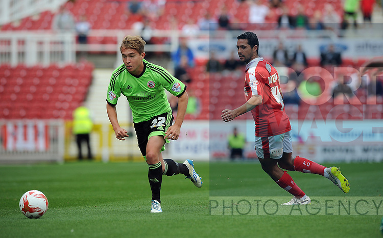 Louis Reed of Sheffield United is challenged by Fabien Robert of Swindon Town<br /> - English League One - Swindon Town vs Sheffield Utd - County Ground Stadium - Swindon - England - 29th August 2015 <br /> --------------------