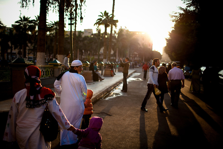 A young Egyptian family walks through the streets of Cairo in the early morning, November 2011, Photo: Ed Giles.