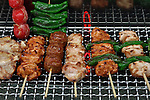 Apr 10, 2010 - Tokyo, Japan - Imitation Yakitori are displayed at a restaurant supply store located in Kappabashi street in Tokyo on April 10, 2010. Kappabashi-dori, also known just as Kappabashi or Kitchen Town, is almost entirely populated with shops supplying mass-produced crockery, restaurant furniture, ovens and decorations, through to esoteric items such as the plastic display food  (sampuru). Replica foods are also popular as souvenirs for tourists.