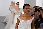 Models walk runway in bridal gowns from the Dennis Basso for Kleinfeld 2018 Bridal Collection on October 5 2017, during New York Bridal Fashion Week.