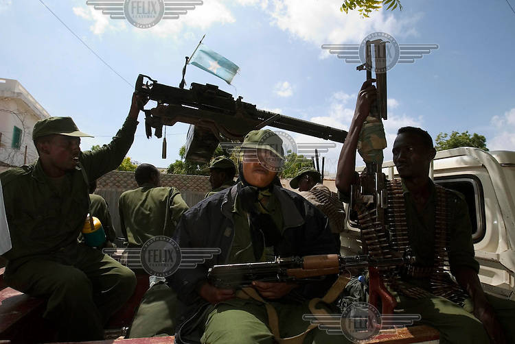 Forces loyal to the transitional government (TFG) patrol on a 'Technical' after taking over Mogadishu. Backed by the Ethiopian military, TFG troops quickly captured territory previously held by the Union of Islamic Courts (UIC). Shukri (20, centre) has been a fighter for five years. Her husband, Abdi (left) has fought with her for three years.