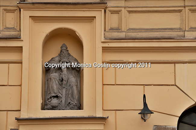 "A niche on a building with a religious sculpture in Krakow, Poland. Krakow is also known at the ""City of Churches"" with over 120 churches and many convents and monasteries"