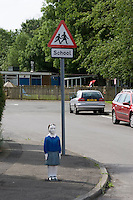 Concrete statues of Children placed outside schools in an effort to encourage passing drivers to slow down..©shoutpictures.com..john@shoutpictures.com