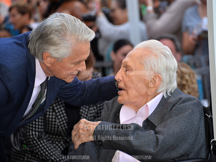 LOS ANGELES, CA. November 06, 2018: Michael Douglas &amp; Kirk Douglas at the Hollywood Walk of Fame Star Ceremony honoring actor Michael Douglas.<br /> Pictures: Paul Smith/Featureflash