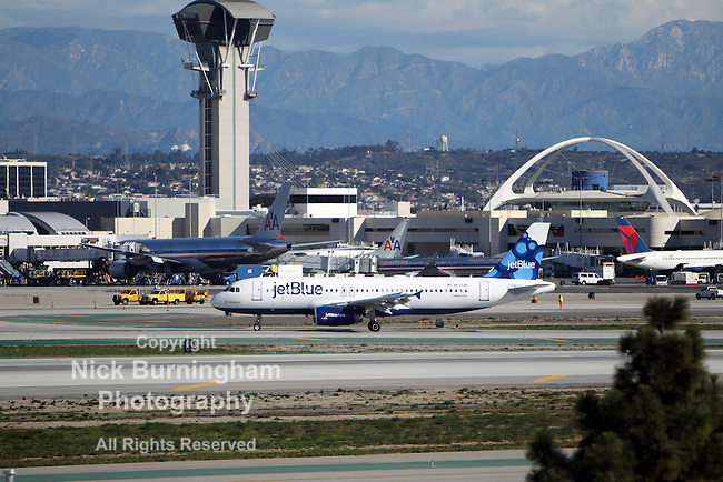 LOS ANGELES, CALIFORNIA, USA - JANUARY 28, 2013 - Jetblue Airbus A320-214 taxis at Los Angeles Airport on January 28, 2013. The plane has a range of range 3,300 miles with 150 passengers.