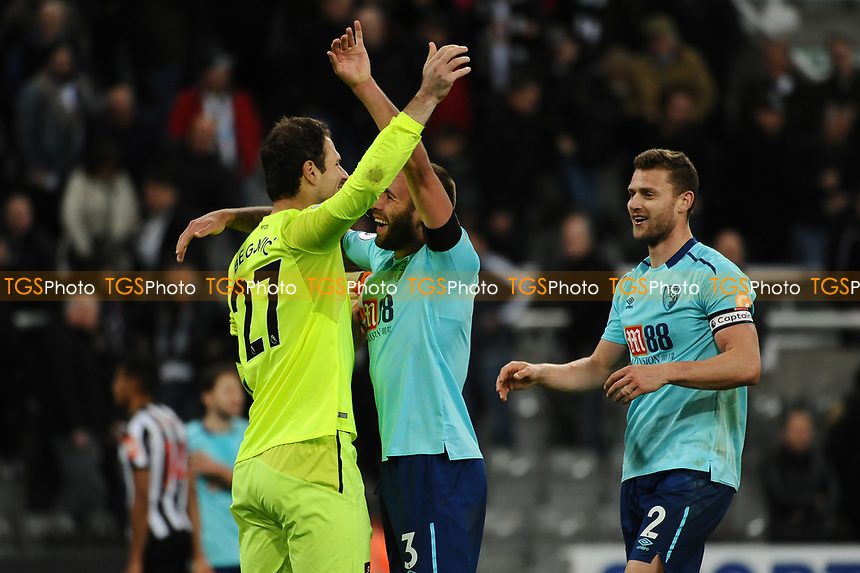 Asmir Begovic of Bournemouth and Steve Cook of Bournemouth celebrate at the final whistle during Newcastle United vs AFC Bournemouth, Premier League Football at St. James' Park on 4th November 2017