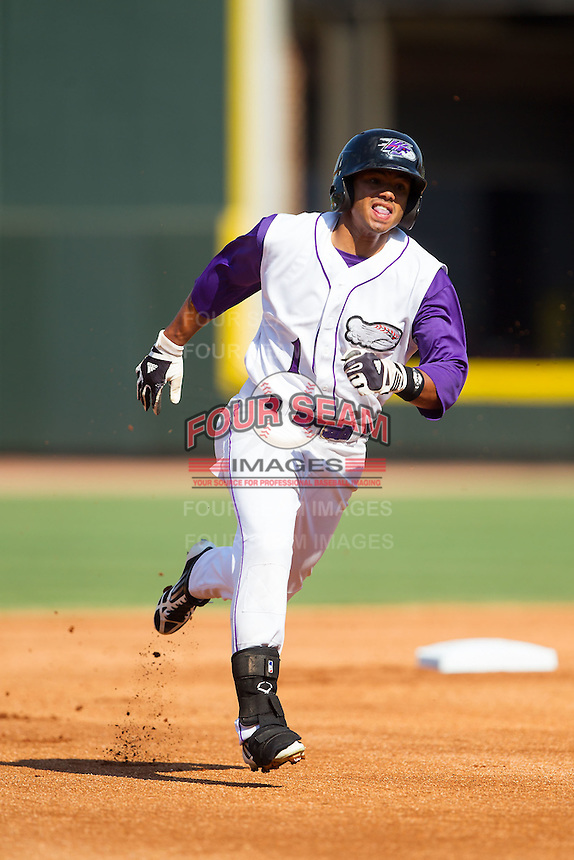 Jacob May (1) of the Winston-Salem Dash hustles towards third base against the Wilmington Blue Rocks at BB&T Ballpark on July 6, 2014 in Winston-Salem, North Carolina.  The Dash defeated the Blue Rocks 7-1.   (Brian Westerholt/Four Seam Images)