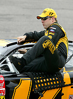 Matt Kenseth climbs into his car during qualifying for the Pop Secret 400 NASCAR Winston Cup race at Rockingham, NC on Friday, November 7, 2003. (Photo by Brian Cleary)