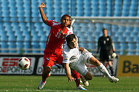 Kelyn Rowe (right) battles for the ball. USA Men's Under 20 defeated Panama 2-0 at Estadio Mateo Flores in Guatemala City, Guatemala on April 2nd, 2011.