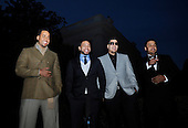 """Washington, DC - October 13, 2009 -- Musicians Aventura, (L tor R) Anthony """"Romeo"""" Santos, Henry Santos Jeter, Max Santos, and Lenny Santos attend a White House Music Series """"Fiesta Latina"""" on the South Lawn of the White House in Washington on Tuesday, October 13, 2009. .Credit: Alexis C. Glenn / Pool via CNP"""