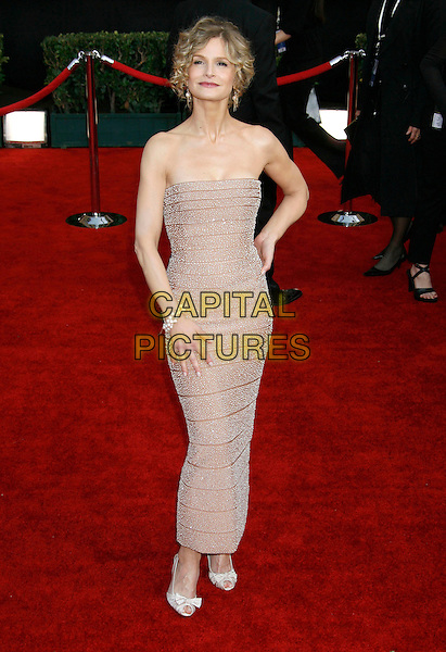 KYRA SEDGWICK .Red Carpet Arrivals - 13th Annual Screen Actors Guild (SAG) Awards, held at the Shrine Auditorium, Los Angeles, California, USA, 28 January 2007..full length cream beige  strapless dress.CAP/ADM/RE.©Russ Elliot/AdMedia/Capital Pictures.