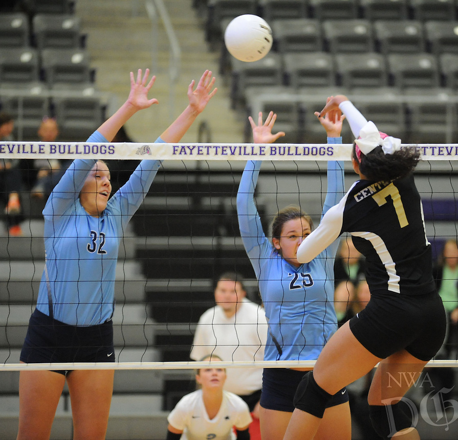 STAFF PHOTO ANDY SHUPE - Kiara Williams (7) of Little Rock Central sends the ball over the net as Paige Williams (25) and Kimberly Huff (32) of Har-Ber defend during play Tuesday, Oct. 28, 2014, in the Class 7A state tournament at Fayetteville High School.
