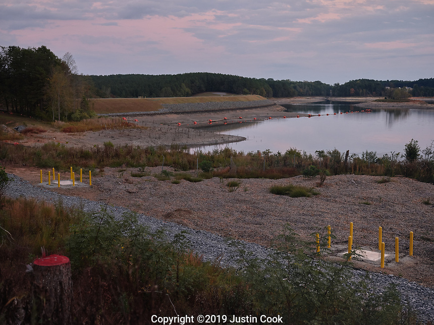 The coal ash pond near the Belews Creek Steam Station, a coal-fired generator at Belews Creek, North Carolina, Saturday, October 12, 2019 .(Justin Cook)