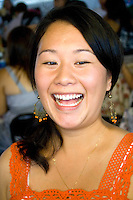 Very happy SE Asian woman working in cafe selling Hmong cuisine. Hmong Sports Festival McMurray Field St Paul Minnesota USA