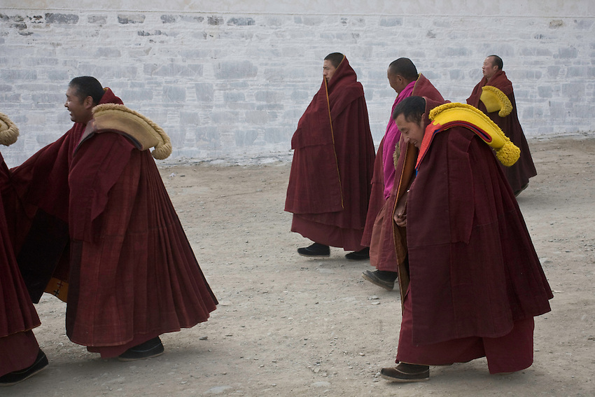 Some monks are leaving the Great Hall of Assembly after the ceremony of the morning, Labrang.