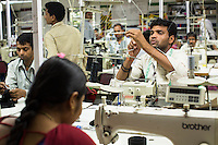 Workers sew clothes in the Pratibha vertically integrated garment unit in Indore, Madhya Pradesh, India on 11 November 2014. Photo by Suzanne Lee for Fairtrade