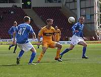 Derek Riordan plays the ball past Keith Lasley into the path of David Robertson in the Motherwell v St Johnstone Clydesdale Bank Scottish Premier League match played at Fir Park, Motherwell on 28.4.12.
