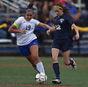 Emma Cooney #12 of Massapequa, right, and Victoria Galvez #19 of Port Washington battle for control during the first half of a Nassau County varsity girls soccer game at Burns Park in Massapequa on Monday, Oct. 15, 2018. After a scoreless first half, Cooney netted the first goal of the game early in the second half. Massapequa went on to win 3-0.
