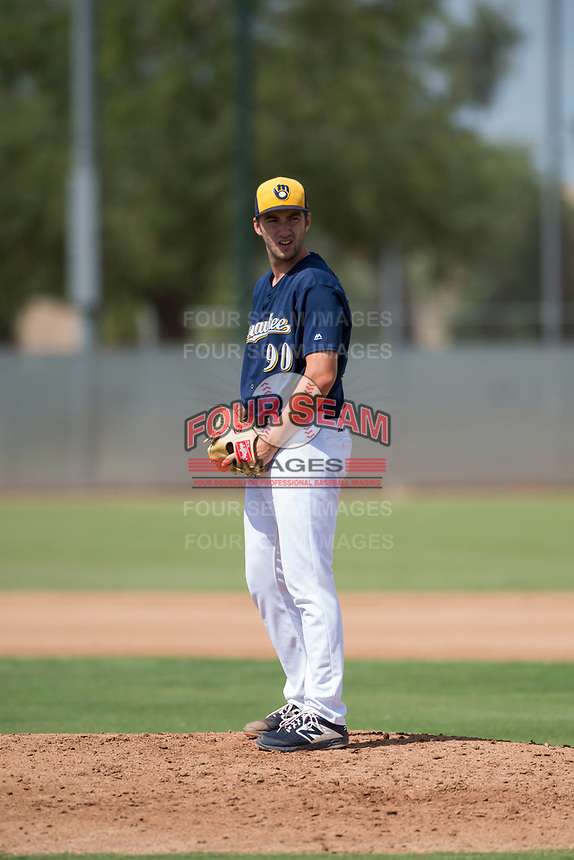 Milwaukee Brewers relief pitcher Justin Bullock (90) gets ready to deliver a pitch during an Instructional League game against the Los Angeles Dodgers at Maryvale Baseball Park on September 24, 2018 in Phoenix, Arizona. (Zachary Lucy/Four Seam Images)