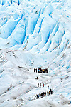 2 groups of trekkers meet on Glacier Perito Moreno in the Parque Nacional los Glaciares, Argentina