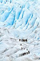 2 groups of trekkers meet on Glacier Perito Moreno in the Parque Nacional los Glaciares, Argentina