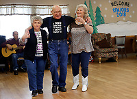 NWA Democrat-Gazette/DAVID GOTTSCHALK Katy Phillips (from left), David Mitchell and Jewell Barnett square dance Tuesday, January 2, 2018, together at the Farmington Senior Center. Live music is performed by volunteers that encourage audience members to dance and come to the microphone and sing.