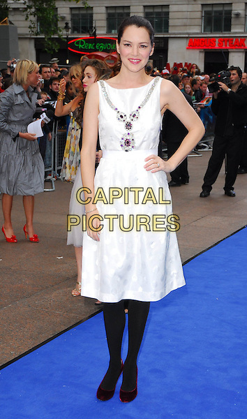 "JACINDA BARRETT.At the UK Film Premiere of ""Poseidon"", .Empire Leicester Square, London, .May 28th 2006..full length white dress black tights hand on hip purple stones.Ref: CAN.www.capitalpictures.com.sales@capitalpictures.com.©Can Nguyen/Capital Pictures"