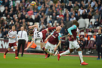 James Collins of West Ham clears a cross from Ashley Barnes of Burnley  during West Ham United vs Burnley, Premier League Football at The London Stadium on 10th March 2018
