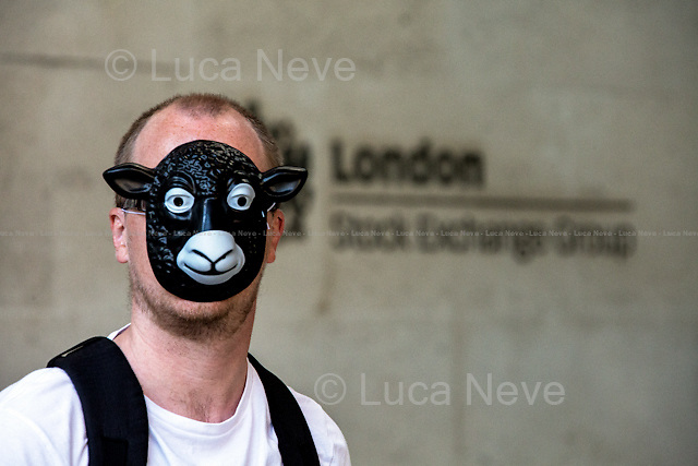 London, 26/09/2015. Today, comedian, journalist and political activist Mark Thomas staged a &quot;Shaun the Sheep&quot; demonstration in Paternoster Square, financial heart of the City of London and home of the London Stock Exchange. From the organiser Facebook page: &lt;&lt;Some of you may know I have been banned for life from walking in 6 London streets owned and controlled by the Oxford Properties Group, these streets are in Paternoster Sq. As we have had a right of way on these streets since Anglo Saxon times it seems a tad excessive, as my crime was walking dressed as a sheep. So I am organising a Mass Trespass of Shaun the Sheep! The aim is to get as many people as possible on to the Square wearing Shaun the Sheep masks and do a walk. [&hellip;]&gt;&gt;. <br />