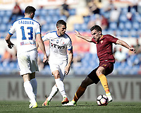 Calcio, Serie A: Roma, stadio Olimpico, 14 aprile 2017.<br /> Roma's Kevin Strootman (r) in action with Atalnta's Remo Freuler (c) and Mattia Caldara (l) during the Italian Serie A football match between Roma and Atalanta at Rome's Olympic stadium, April 14, 2017.<br /> UPDATE IMAGES PRESS/Isabella Bonotto