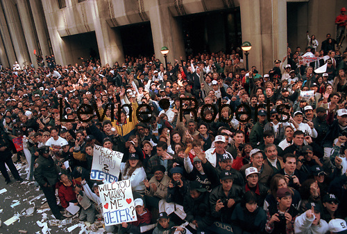 Hundreds of thousands line Broadway in Lower Manhattan in New York on October 29, 2996 for the ticker tape parade thrown for the New York Yankees after their win in the World Series of Baseball. (© Richard B. Levine)