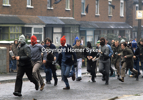Riots rioting Catholic youth attacking the British army Belfast The Troubles Northern Ireland Uk 1980s