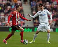 (L-R) Javier Manquillo of Sunderland against Ki Sung-Yueng of Swansea City during the Premier League match between Sunderland and Swansea City at the Stadium of Light, Sunderland, England, UK. Saturday 13 May 2017
