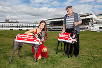 NO REPRO FEE. 2/8/2011. Pictured today was new Miss Universe Ireland, Aoife Hannon, and champion greyhounds Feetonfire (black) and Kaiser and trainer Larry Mason from Dundrum in Shelbourne Park, Dublin who were on hand for the first trap draw to launch the richest greyhound race in the world, The Ladbrokes.com Irish Greyhound Derby. TheLadbrokes.com Irish Greyhound Derby offers a massive prize fund of EUR225,000, and is run over a distance of 550yds and takes place in Shelbourne Park on Saturday 10th September with qualifying rounds beginning on 3rd August 2011. The Trap Draw takes place to determine the race and trap for each greyhound entered in to the eagerly anticipated Derby, and with 150 dogs due to take part this years competition is gearing up to be one of the most exciting in the history of the sport. Picture James Horan/Collins