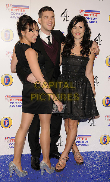 Kerry Howard, Russell Tovey & Sarah Solemani.attending the British Comedy Awards 2011, Fountain Studios, Wembley, England, UK, 16th December 2011..arrivals full length black dress arm around suit tie maroon purple jumper .CAP/CAN.©Can Nguyen/Capital Pictures.