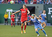 Portland, Oregon - Wednesday June 22, 2016: Portland Thorns FC forward Christine Sinclair (12) and Chicago Red Stars defender Julie Johnston (8) go up for a header during a regular season National Women's Soccer League (NWSL) match at Providence Park.