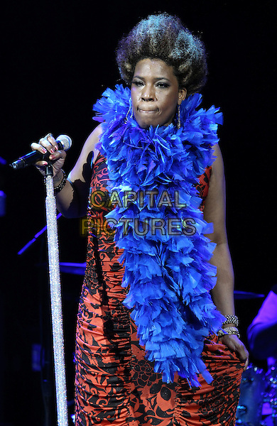 Macy Gray .performs at The Pearl inside Palms Casino Resort, Las Vegas, Nevada, USA, 4th August 2012..music concert live gig on stage half length blue feather boa red black print dress microphone singing .CAP/ADM/MJT.© MJT/AdMedia/Capital Pictures.