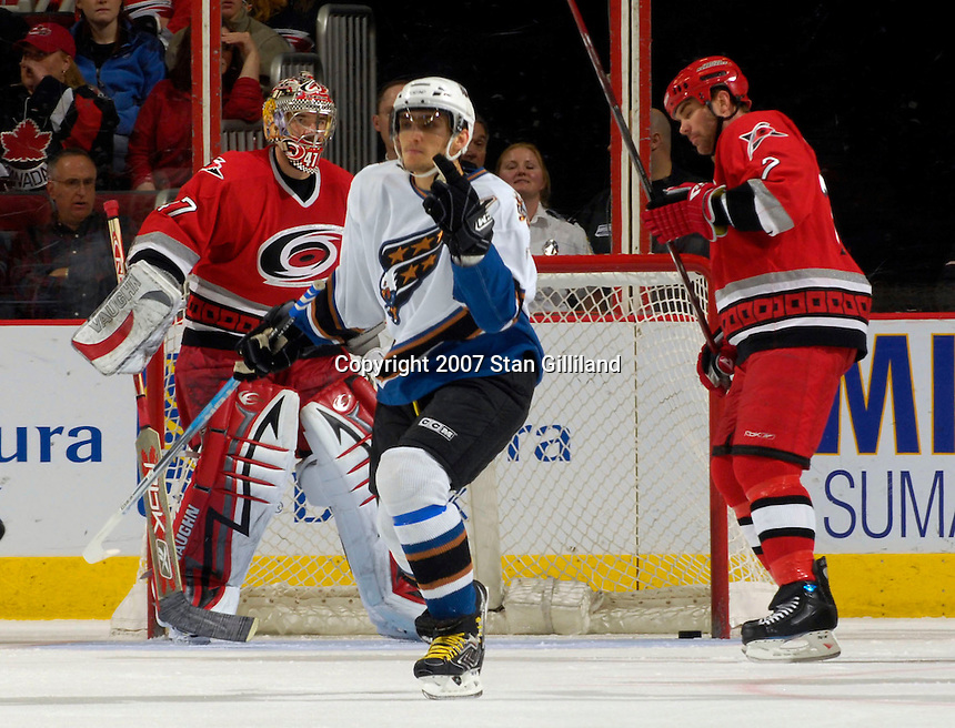 Washington Capitals' Alexander Ovechkin celebrates his goal against the Carolina Hurricanes' John Grahame, left, and Niclas Wallin, right, Thursday, March 22, 2007 at the RBC Center in Raleigh, NC. Carolina won 4-3.
