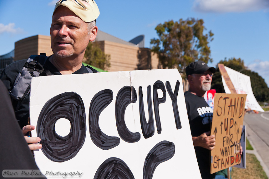 Ted (left) and Steve (right) hold signs at the Occupy Orange County, Irvine camp on November 5.