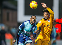 Myles Weston of Wycombe Wanderers & Jennison Myrie-Williams of Newport County chase down the ball during the Sky Bet League 2 match between Wycombe Wanderers and Newport County at Adams Park, High Wycombe, England on 2 January 2017. Photo by Andy Rowland.