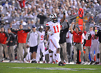 25 October 2014:  Ohio State S Vonn Bell (11) celebrates after an interception during the first series of the game. The Ohio State Buckeyes defeated the Penn State Nittany Lions 31-24 in 2 OTs at Beaver Stadium in State College, PA.