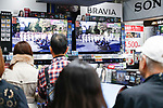People watch a screen displaying Japan's Emperor Naruhito and Empress Masako during a royal parade in Tokyo to celebrate the emperor's enthronement on November 10, 2019, Japan. (Photo by Rodrigo Reyes Marin/AFLO)