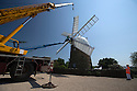 07/06/16<br /> <br /> ***With Video:   https://youtu.be/6A5HVYjOzms ****<br /> <br /> The sails are finally turning again on Britain's only working six-sailed stone windmill, in Heage near Belper, Derbyshire after a huge crane hoisted them into position yesterday.<br /> <br /> The six sails were removed in November 2015 to allow restoration work to be carried out over winter, after wet rot was discovered in the beams supporting the sails at Heage Windmill last summer.<br /> <br /> As well as replacing the supporting beams that stretch as far as the mill's fantail, the sails and windmill 'cap' have also been restored and painted by a team of volunteers.<br /> <br /> The cost of around £80,000 to carry out the essential repairs has been donated by local businesses and through the efforts of numerous fund-raising initiatives by the volunteer team. <br /> <br /> The windmill first ran in 1797 and continued to mill commercially until it was struck by lightning in 1919.<br /> <br /> It still produces small batches of wholemeal flour, stoneground from British wheat harvested in a traditional way, in a natural environment free from synthetic fertilisers and pesticides.<br /> <br /> All Rights Reserved: F Stop Press Ltd. +44(0)1335 418365   www.fstoppress.com Timelapse with voiceover here:   <br />