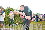 Jack Davies and Esme Wilson both from Kenmare in action at the wife-carrying championships in Sneem this weekend.