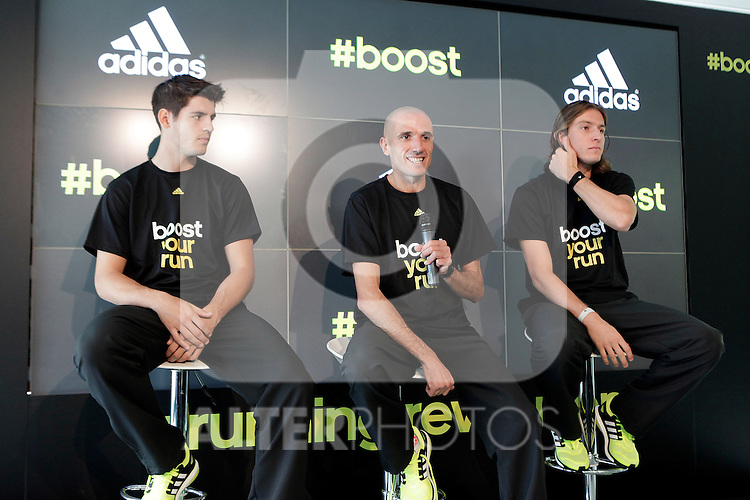 Real Madrid´s Morata (L), athlete Chema Martinez (C) and Atletico de Madrid´s Filipe Luis (R) attend an official Adidas presentation at Torre Espacio in Madrid, Spain. (ALTERPHOTOS/Victor Blanco)