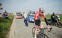 Pim Ligthart (NLD/Lotto-Belisol) just pushed by team manager Marc Sergeant (BEL) after a mechanical<br /> <br /> 57th E3 Harelbeke 2014