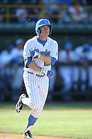 Ty Moore (29) of the UCLA Bruins runs to first base during a game against the Hofstra Pride at Jackie Robinson Stadium on March 14, 2015 in Los Angeles, California. UCLA defeated Hofstra, 18-1. (Larry Goren/Four Seam Images)