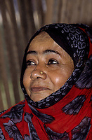 Salalah, Oman.  Middle-aged Woman with Scarf and Nose-pin.